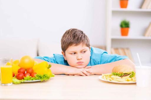 غذاهای فوقالعاده فرآوری شده عامل چاقی کودکان,چاقی کودکان با غذاهای فوقالعاده فرآوری شده