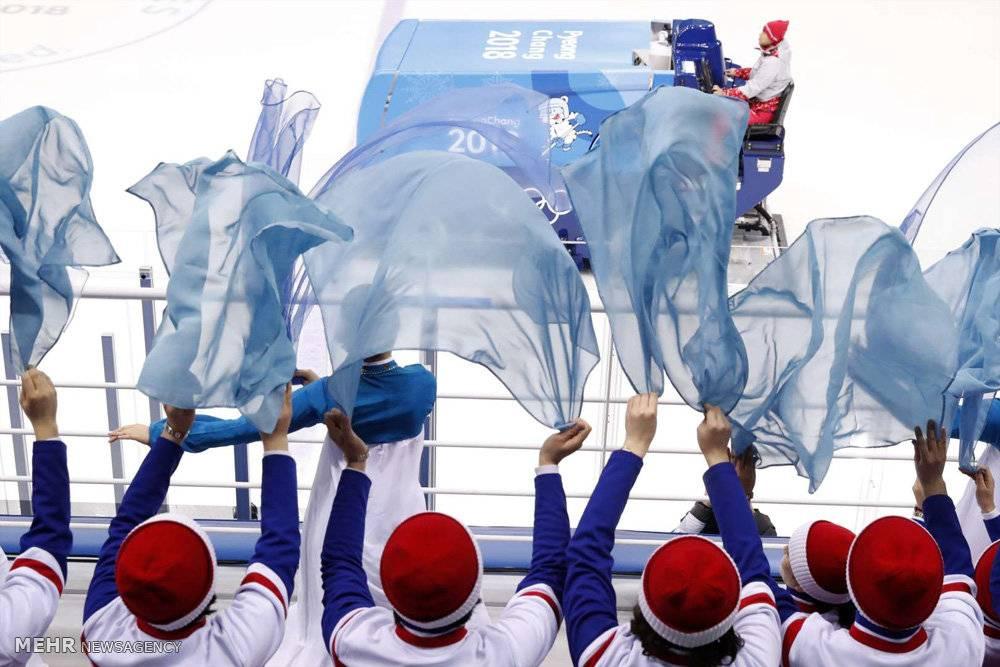 تصاویرتشویق کنندگان ورزشکاران کره شمالی,عکس های تشویق ورزشکاران درالمپیک زمستانی2018,تصاویر زنان تشویق کننده ورزشکاران کره شمالی
