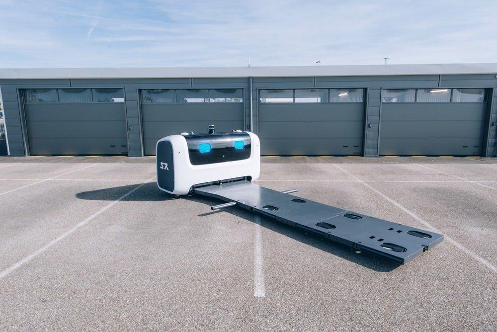 تصاویر ربات ها در فرودگاه,عکس های پارکینگ در فرودگاه,تصاویر پارک خودرو توسط ربات