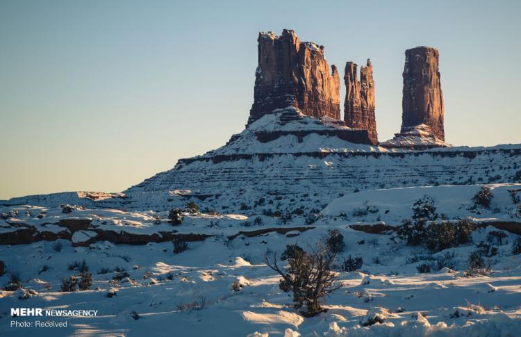 تصاویر دره مانومنت آمریکا,عکس پدیده های آب و هوایی در دره مانومنت آمریکا,تصاویر دره مانومنت در مرز دو ایالت یوتا و آریزونای آمریکا