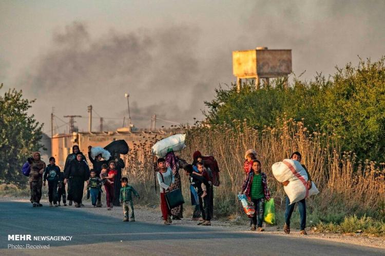 تصاویر فرار غیرنظامیان از شمال سوریه,عکس های افراد غیرنظامی کرد,تصاویر تنش ها در منطقه