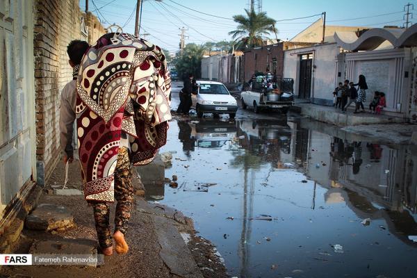 فقر مطلق و خانهبهدوشی مردمِ خوزستان نفتخیز؛ اهوازیها در محاصره آب و فاضلاب /عکس