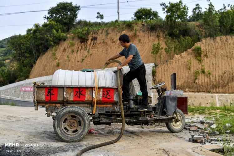 تصاویر حفر چاه عمیق در روستای نانلینگ چین,عکس های حفر چاه عمیق در روستای نانلینگ چین,تصاویر آبرسانی روستای چینی با حفر چاه عمیق