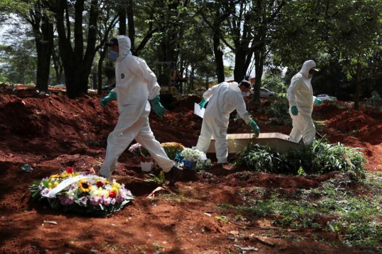 تصاویر قربانیان ویروس کرونا,عکس های تلفات ناشی از کرونا,تصاویر دفن اجساد مبتلا به کرونا