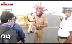 فیلم/ پلیس هند با کلاه کرونایی