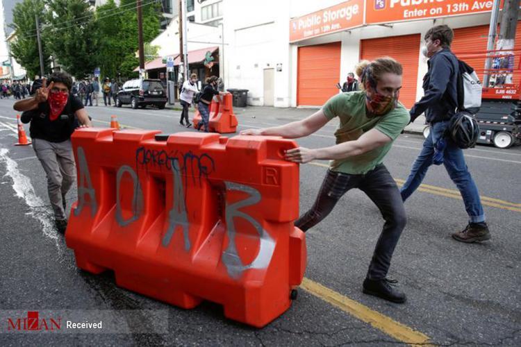 تصاویر اعتراضات در سیاتل,عکس های تظاهرات اعتراضی در سیاتل,تصاویر تظاهرات اعتراضی سیاتل