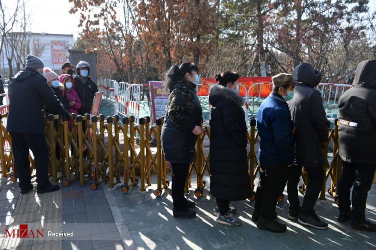 تصاویر تستهای جمعی کرونا در چین,عکس های گرفتن تست کرونا در چین,تصاویر تست کرونا در کشور چین