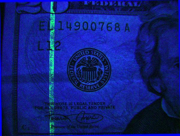 پول جعلی,تشخیص چک پول تقلبی,پول تقلبی